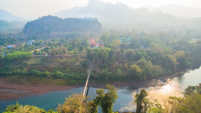 Suspension bridge  across Kwai river. Connect Tha Kha Nun temple and Thong Pha Phom village in Kanchanaburi province Stock Photos
