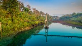 Suspension bridge  across Kwai river. Connect Tha Kha Nun temple and Thong Pha Phom village in Kanchanaburi province Stock Image