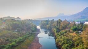 Suspension bridge  across Kwai river. Connect Tha Kha Nun temple and Thong Pha Phom village in Kanchanaburi province Royalty Free Stock Photos