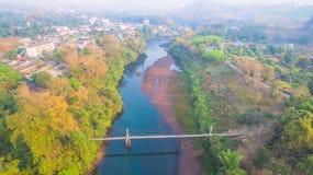 Suspension bridge  across Kwai river. Connect Tha Kha Nun temple and Thong Pha Phom village in Kanchanaburi province Stock Photo