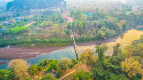 Suspension bridge  across Kwai river. Connect Tha Kha Nun temple and Thong Pha Phom village in Kanchanaburi province Royalty Free Stock Photography