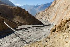 Suspension bridge across mountain river, Himalayas, Nepal Royalty Free Stock Photo