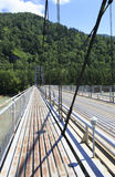 Suspension bridge across mountain river Katun. Altai. Royalty Free Stock Photos