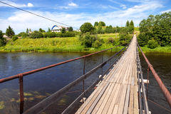 Suspension bridge across the Msta river Stock Images