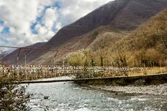 A suspension bridge across the River in the gorge. On their way to Lake Ritsa in Abkhazia Royalty Free Stock Image
