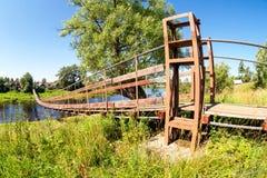 Suspension bridge across the river Msta. Novgorod region, Russia Royalty Free Stock Image
