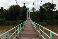 Suspension bridge across the river. At Ubon in Thailand Stock Photography