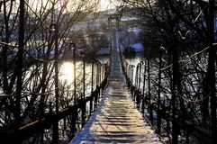 Suspension bridge across the river in winter Royalty Free Stock Photos