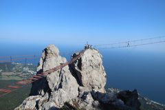 The suspension bridge on Ai-Petri mountain, Crimea. The suspension bridge on Ai-Petri mountain 1,234.2 m is the entertainment for tourists. Ai-Petri is a peak in stock images
