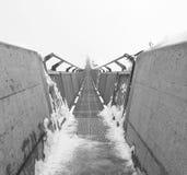 Suspension bridge in Alps. Bridge construction in Switzerland royalty free stock image