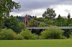 Suspension Bridge at Alton Baker Park. Pedestrian suspension bridge at Alton Baker park in Eugene, OR Royalty Free Stock Photography