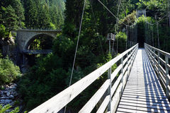 Suspension bridge. And arch bridge in the forest, Switzerland Royalty Free Stock Images