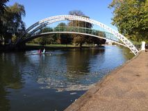 Suspension bridge,Bedford, United Kingdom. The suspension bridge over the river Great Ouse in Bedford, United Kingdom. Rowers can be seen rowing under the Royalty Free Stock Photography