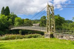Suspension Bridge in Betws y Coed. The Sappers suspension bridge over the River Conwy built in 1930 and a prominent landmark in the village of Betws-y-Coed in royalty free stock images