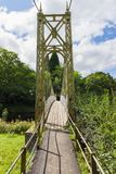 Suspension Bridge in Betws y Coed. The Sappers suspension bridge over the River Conwy built in 1930 and a prominent landmark in the village of Betws-y-Coed in stock image
