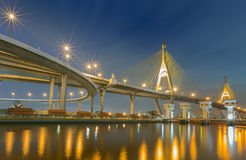 Suspension bridge (Bhumibol bridge) with street light reflect in river Royalty Free Stock Photography