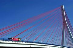 Suspension bridge on blue sky Stock Image