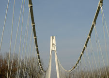 Suspension bridge. With cables reaching to the deck Stock Photo