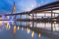 Suspension bridge connect to highway overpass. At twilight with reflection Stock Images