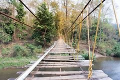 Suspension bridge, Crossing the river, stock images