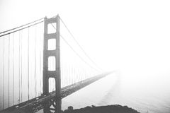 Suspension bridge on a foggy day Royalty Free Stock Photos