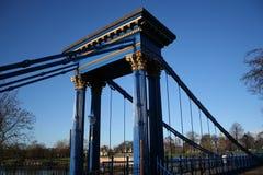 Suspension bridge Glasgow. Blue pedestrian suspension bridge across the River Clyde Glasgow Stock Images
