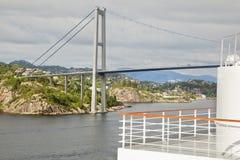 Suspension bridge in gloomy weather Stock Image