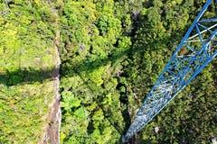 Suspension bridge, Gunung Mat Cincang, Langkawi. Curved suspension bridge for pedestrians on Gunung (Mount) Mat Cincang in Langkawi, Malaysia Royalty Free Stock Image