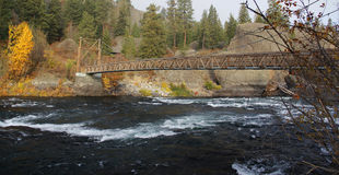 Suspension bridge on hiking trail crosses river Stock Photos