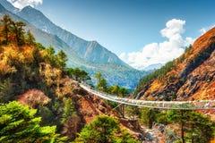 Suspension bridge in Himalaya mountains, Nepal. Khumbu valley, Everest region, Sagarmatha national park royalty free stock photo