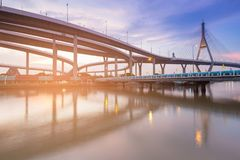 Suspension bridge and interchanged overpass water front. With sunset tone Royalty Free Stock Photography
