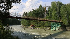 Suspension bridge between the islands on the Katun River. Altai Krai. stock footage