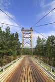 Suspension bridge between the islands on mountain river Katun. Stock Photo