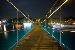 Suspension Bridge and the lights at night. In Thailand Stock Photography