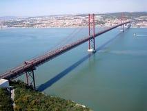 Suspension bridge in Lisbon, Portugal. Suspension bridge Ponte 25 de April over the Tagus river in Lisbon, Portugal Stock Photos