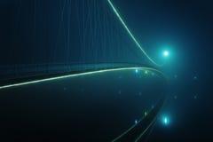 Suspension bridge lit at night Stock Images