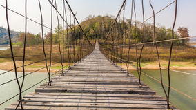 Suspension bridge made of wood and sling Royalty Free Stock Images