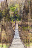 Suspension bridge made of wood and sling Royalty Free Stock Photography