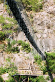 Suspension bridge in the mountains Stock Photography