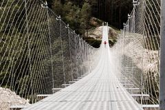 Suspension bridge in the mountains near the village of Perarollo di Cadore stock image