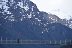 Suspension bridge in the mountains of New Zealand's south island Royalty Free Stock Photography