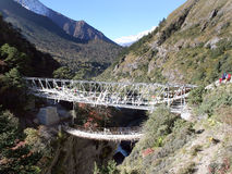 Suspension Bridge - Nepal. Suspension Bridge located between Tengboche and Pangboche. You can see Tengboche in the far distance and the Imja Khola river below Royalty Free Stock Photography