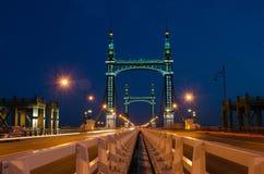 Suspension Bridge at Night Stock Photo