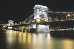 Suspension bridge at night Stock Photos