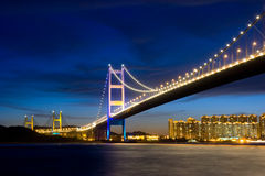 Suspension bridge at night. Hong kong Royalty Free Stock Images