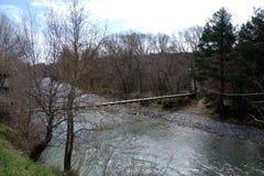 A suspension bridge in a non-urban scene day.  stock photos