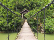 Suspension bridge over asian river Royalty Free Stock Image