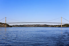Suspension bridge. Over the bay Stock Images