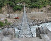Suspension bridge over Bhote Khosi Stock Images