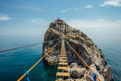 Suspension bridge over Black sea in Simeiz, Crimea.  royalty free stock photos
